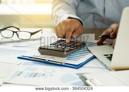 Financial Report- Business Accounting Money Stack Concept Business Man Using Calculator Graph Discus
