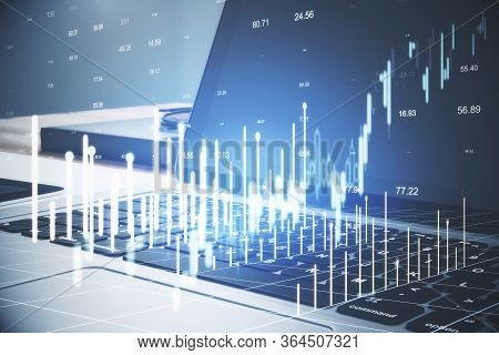 Close Up Of Notebook With Forex Chart On Desktop And Blurry Bokeh Background. Analytics And Trade Co