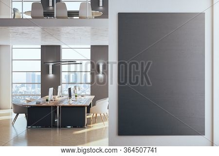 Modern Office Interior With Daylight And Empty Black Poster. Workplace And Design Concept. 3d Render