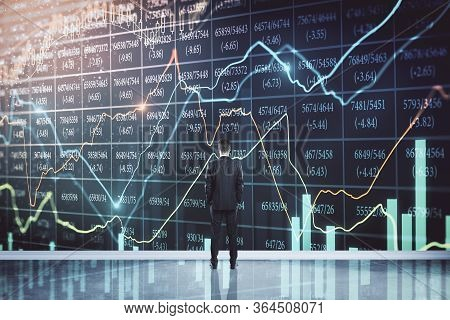 Pensive Businessman Looking On Economic Crisis Stock Charts And Arrow On Virtual Screen. Trade And F