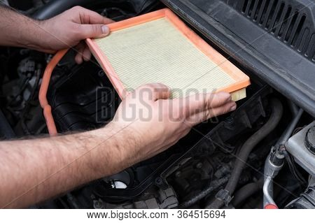 Caucasian Man Changing New Air Filter In Car Engine Bay. Mechanic Repair Or Vehicle Maintenance Conc