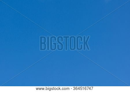 Beautiful Blue Cloudless Sky In Calm Weather .against A Clear Blue Sky