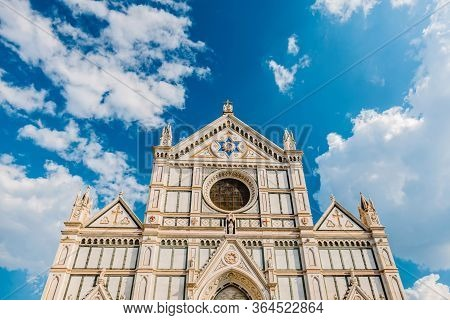 Catholic Cathedral In Florence. The Facade Of A Beautiful Catholic Cathedral Against The Blue Sky. P