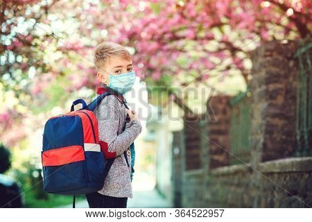 Schoolboy Wearing Face Mask During Corona Virus Outbreak. Back To School Concept.
