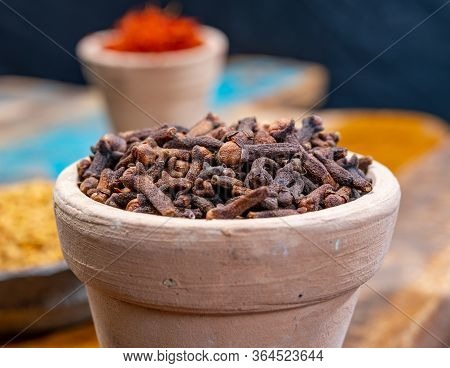Indian Spices Collection, Dried Aromatic Cloves Flower Buds And Another Spices In Clay Bowls Close U