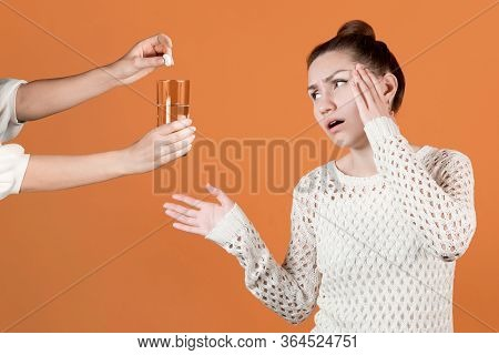 The Girl Really Wants To Get A Pill For The Headache That She Is Offered. A Friend Or Mother Offers
