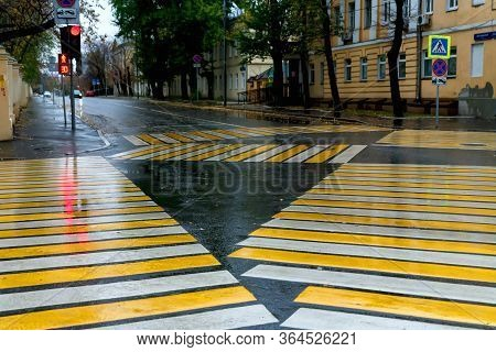 Yellow Marking Of Pedestrian Crossings At The Intersection. Diagonal Marking Of A Pedestrian Crosswa