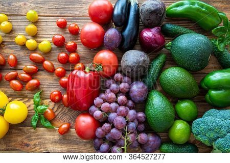 Colorful Rainbow Assortment Of Fresh Fruits And Vegetables On Brown Wooden Rustic Background, Top Vi