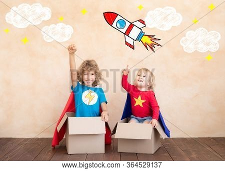 Superheroes Children Playing In Cardboard Box