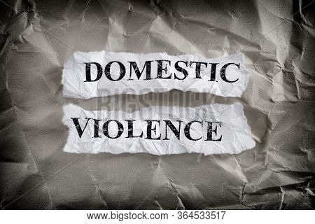 Domestic Violence. Torn Pieces Of Paper With The Words Domestic Violence Written On Them On Crumpled