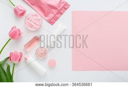 Natural Organic Cosmetic Products With Pink Flowers On White Background. Beauty, Nature Cosmetics Fo