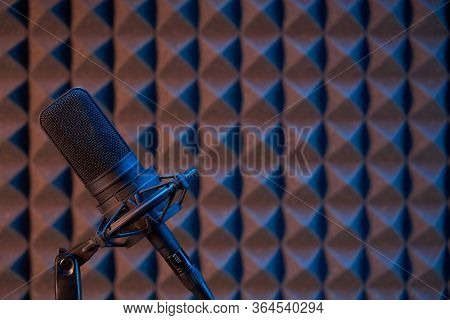 Studio Condenser Microphone On Acoustic Foam Panel Background