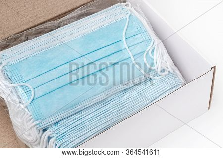 Package Of Surgical Face Masks With Rubber Ear Straps In Cardboard Box. Close-up View Of Large Lot M