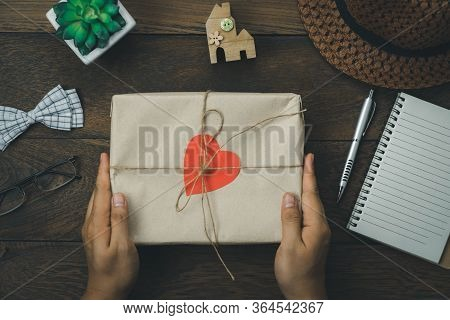 Table Top View Happy Fathers Day Holiday & Office Desk Background Concept.flat Lay Hand Holding Gift