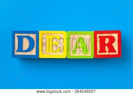 Dear. Wooden Colorful Alphabet Blocks On Blue Background, Flat Lay, Top View.