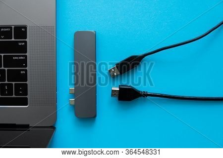 Laptop With Usb Type-c Adapter With Unpluged Usb Cables. The Usb Adapter Under The Type-c Connector