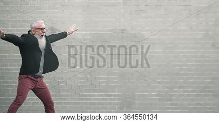 Crazy Man Jumping. Happy Male Celebrating. Energetic Happy Mature Man  In Casual Clothes Jumping, Wa