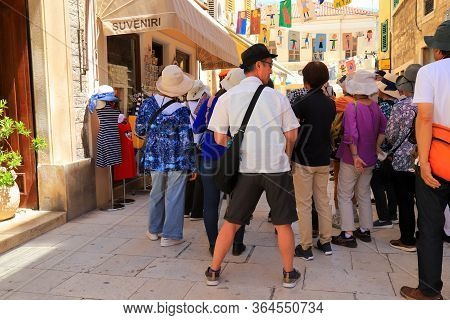 A Crowd Of Chinese Tourists Visiting The Sights And Architecture Of The Old Town Of Croatian Sibenik