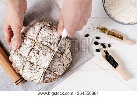 Cutting Bread Loaf With Knife Top View Photography. Woman Chief Person Slicing Cooked Nourishment On