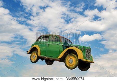 Sverdlovsk Region, Russia - June 15, 2017: Rare Car In A Jump Against A Blue Sky With White Clouds I