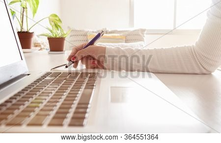 Accounting Businesswoman Working Using Laptop At Home, Telecommuting, Working Remotely During Quaran