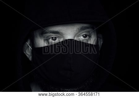 A Man Wearing A Black Respiratory Mask On His Face. A Man In A Black Mask. Virus. Coronavirus. A Guy