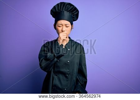 Young beautiful chinese chef woman wearing cooker uniform and hat over purple background feeling unwell and coughing as symptom for cold or bronchitis. Health care concept.
