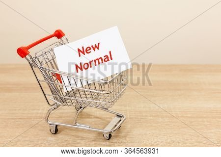 New Normal Phrase Carried Inside A Supermarket Trolley
