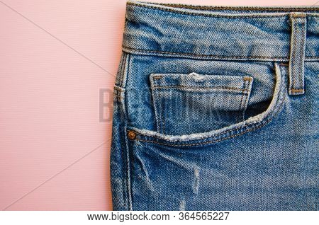 Jeans On A Pink Background. Jeans Elements, Pockets, Seams In Close-up. Ripped Jeans. Copy Space
