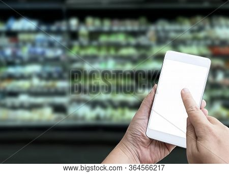 Online Order Grocery Shopping On Touch Screen Concept. Woman Hand Holding Smart Phone For Ordering F