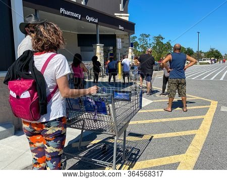 Orlando,fl/usa-5/2/20: Customers Standing In Long Lines Waiting To Get Into  A Sams Club In Orlando,