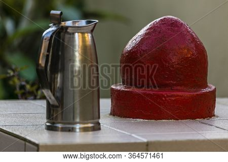 Red Stone With Powerful Religious Symbolism Worshipped By People Of Hinduism Faith