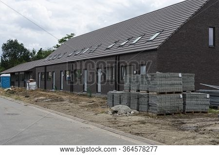 Sint Gillis Waas, Belgium, 16 August 2019. New Construction Of Houses With Stones In The Foreground