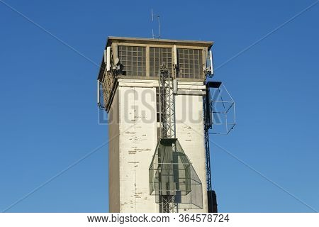 Sint Gillis Waas, Belgium, April 5, 2020, Tower With A Cage Attached To It Used By Longbow Archers