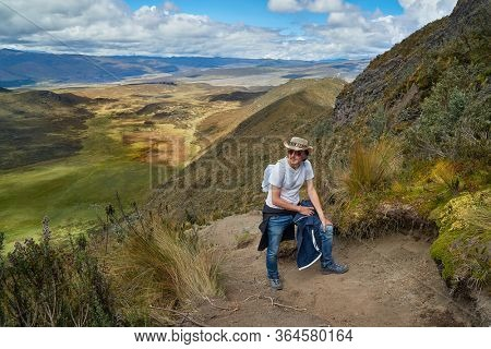 MAn hiking up Mount Ruminahui in Cotopaxi national park in th Andes, Ecuador