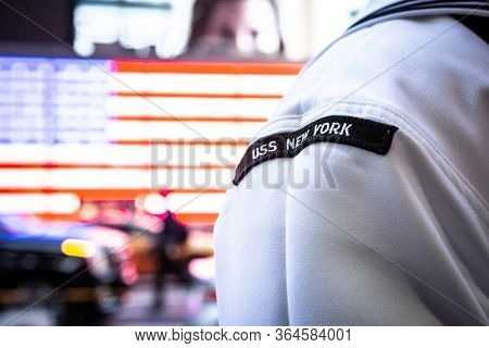 MAY 22 2019-NEW YORK: U.S. Navy Sailor from the USS New York stands at the Armed Forces Recruiting Station on the Military Island Plaza in Times Square during Fleet Week in Manhattan on May 22, 2019.