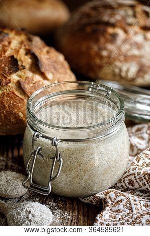 Rye Sourdough Bread In A Jar On A Wooden Table, Active Rye Sourdough In Glass Jar, Sourdough Starter