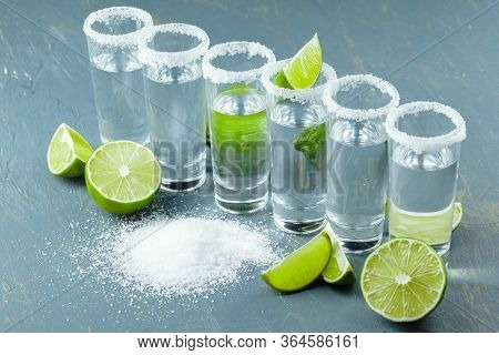 Mexican Tequila In Short Glasses With Lime And Salt