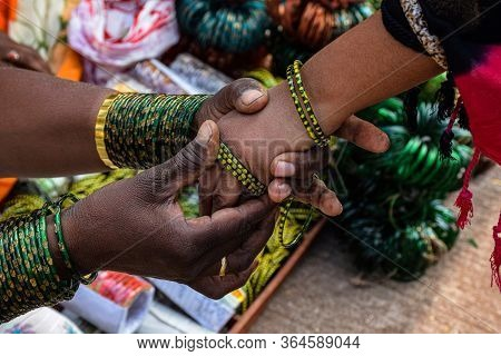 Top View Of Girl Hand Who Wearing Green Color Bangles