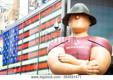 MAY 24 2019-NEW YORK: A giant inflated balloon of a US Marine Corpsman at the Armed Forces Recruiting Station on Military Island Plaza in Times Square during Fleet Week on May 24, 2019.