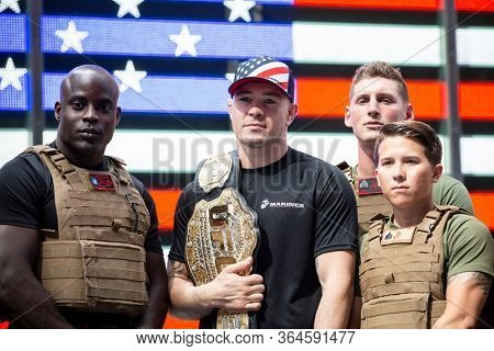MAY 24 2019-NEW YORK: American mixed martial artist champion Colby Covington and U.S. Marines pose for a group photo at the Armed Forces Recruiting Station in Times Square, Fleet Week on May 24, 2019.