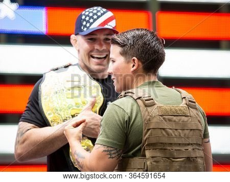 MAY 24 2019-NEW YORK: American mixed martial artist champion Colby Covington laughs along with a U.S. Marine at the Armed Forces Recruiting Station in Times Square, Fleet Week on May 24, 2019.