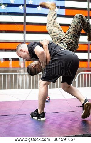 MAY 24 2019-NEW YORK: American mixed martial artist champion Colby Covington flips a U.S. Marine at the Armed Forces Recruiting Station in Times Square, Fleet Week on May 24, 2019.