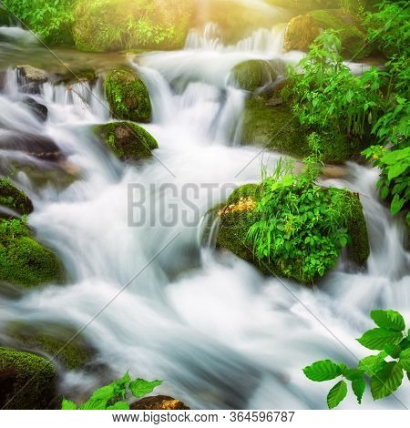 Streams Of Water Beautifully Cascading Down A Wild Small River Through A Mountain Forest, Square For