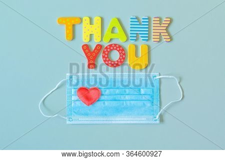 Thank You Words And Heart On Disposable Medical Mask. Face Protective Mask, Heart And Wooden Letters