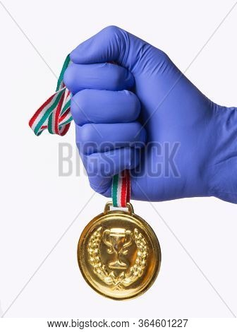 Doctor hand hold a gold honor medal award concept.