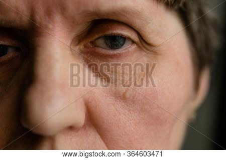 Retired Woman With Tired Glance Full Of Sadness Looking Away, Extreme Close-up Shot