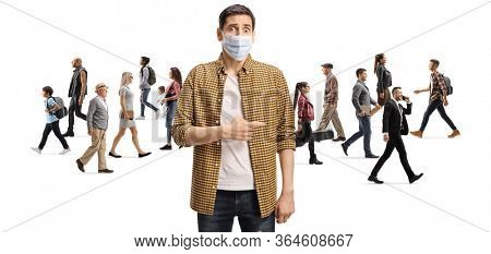 Disappointed man with a protective face mask pointing at a group of people walking without masks isolated on white background