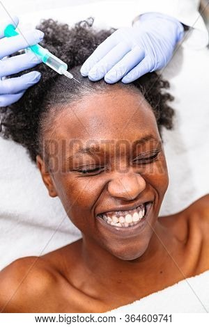 Doctor Aesthetician Makes Head Beauty Injections To A Female African Patient