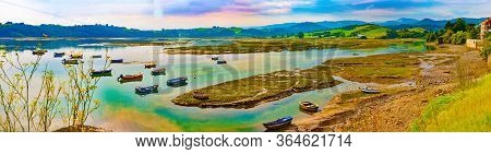 Scenic Mountain And Sea Panoramic Landscape In Northern Spain.green Meadows And Boats In The Port.sa